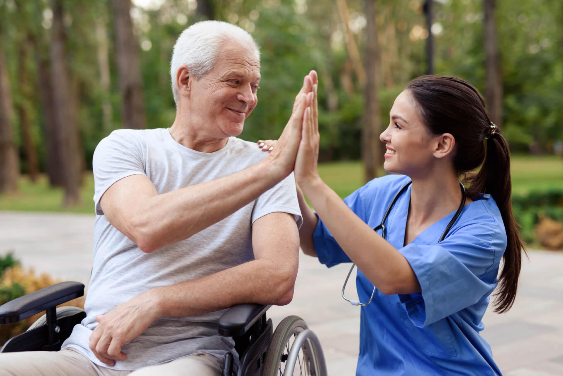 nurse-old-man-wheelchair-high-five (1) (1)