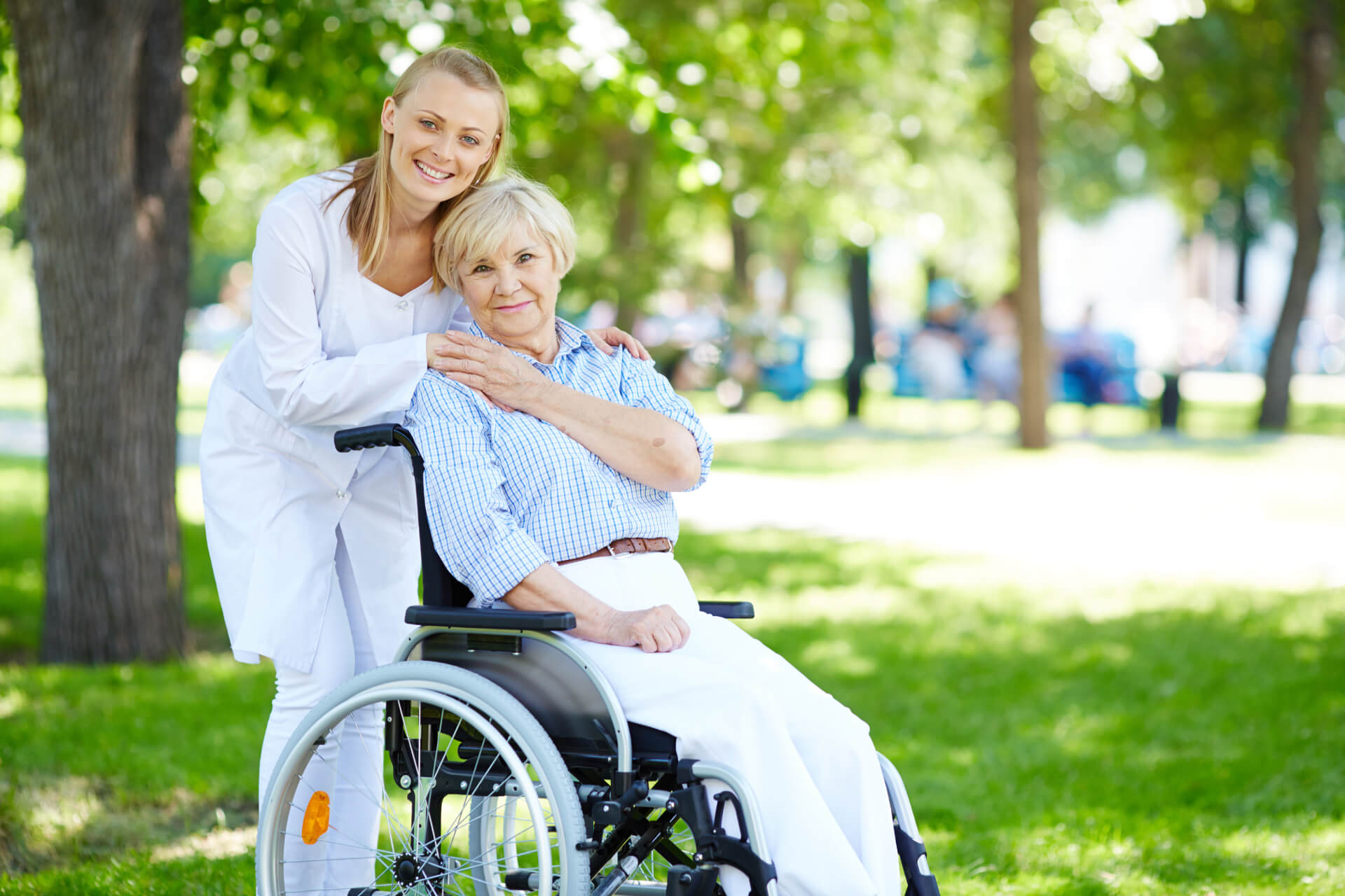senior-woman-with-her-caregiver-outdoor (1) (1)